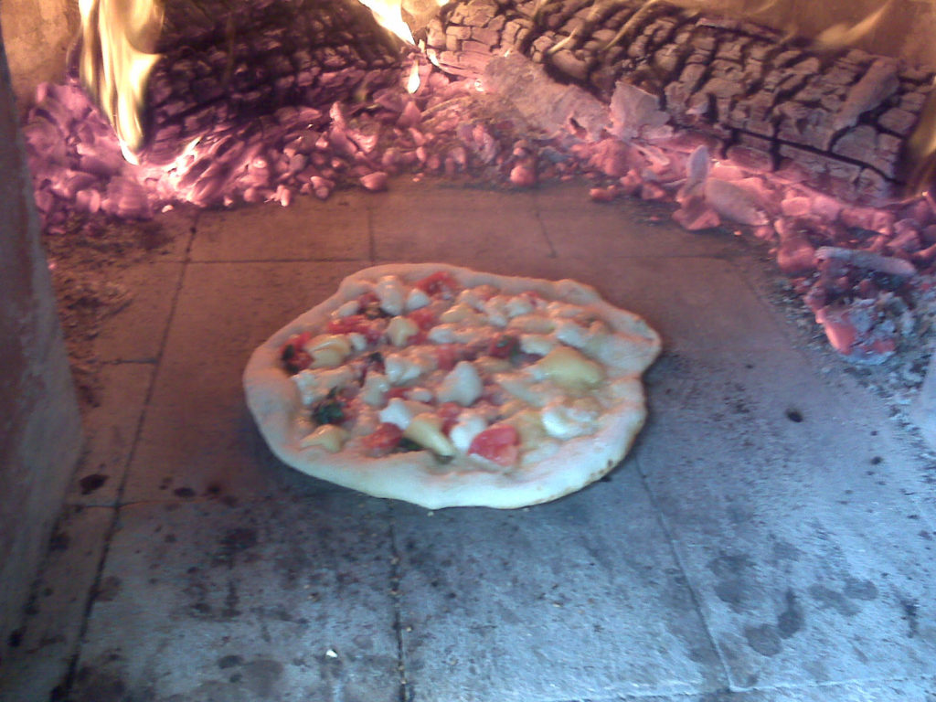 New pizza in oven